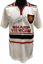 "An unframed signed replica Manchester United away shirt as worn by Ryan Giggs when he scored the amazing winning goal against Arsenal in the F.A.Cup semi final at Villa Park in 1999. The year United went on to win the ""Treble""."